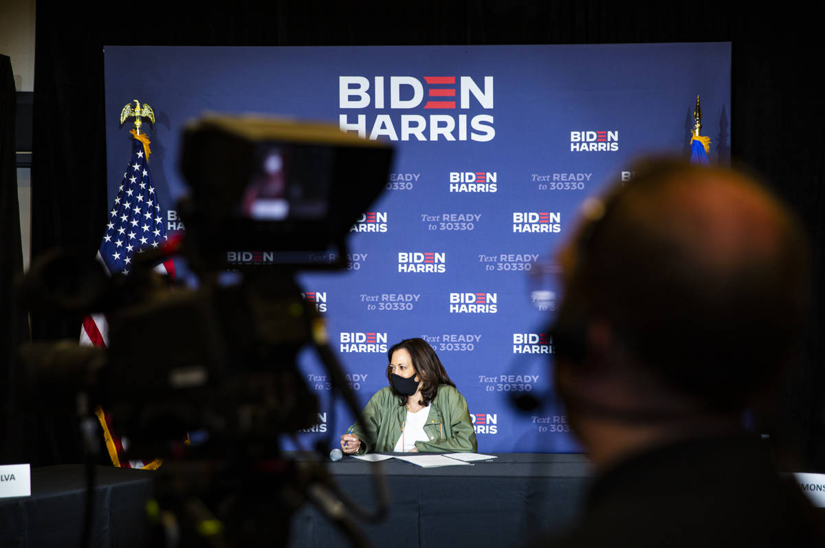 Democratic vice presidential candidate Sen. Kamala Harris, D-Calif., listens during a roundtabl ...