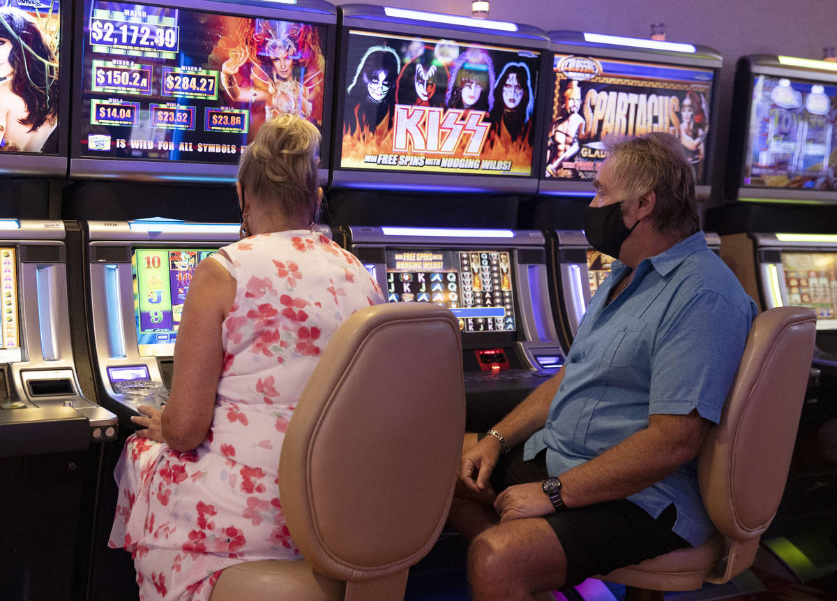 Rex Pierson watches as his wife Shelley, both of Las Vegas, gambles after the Tropicana hotel-c ...