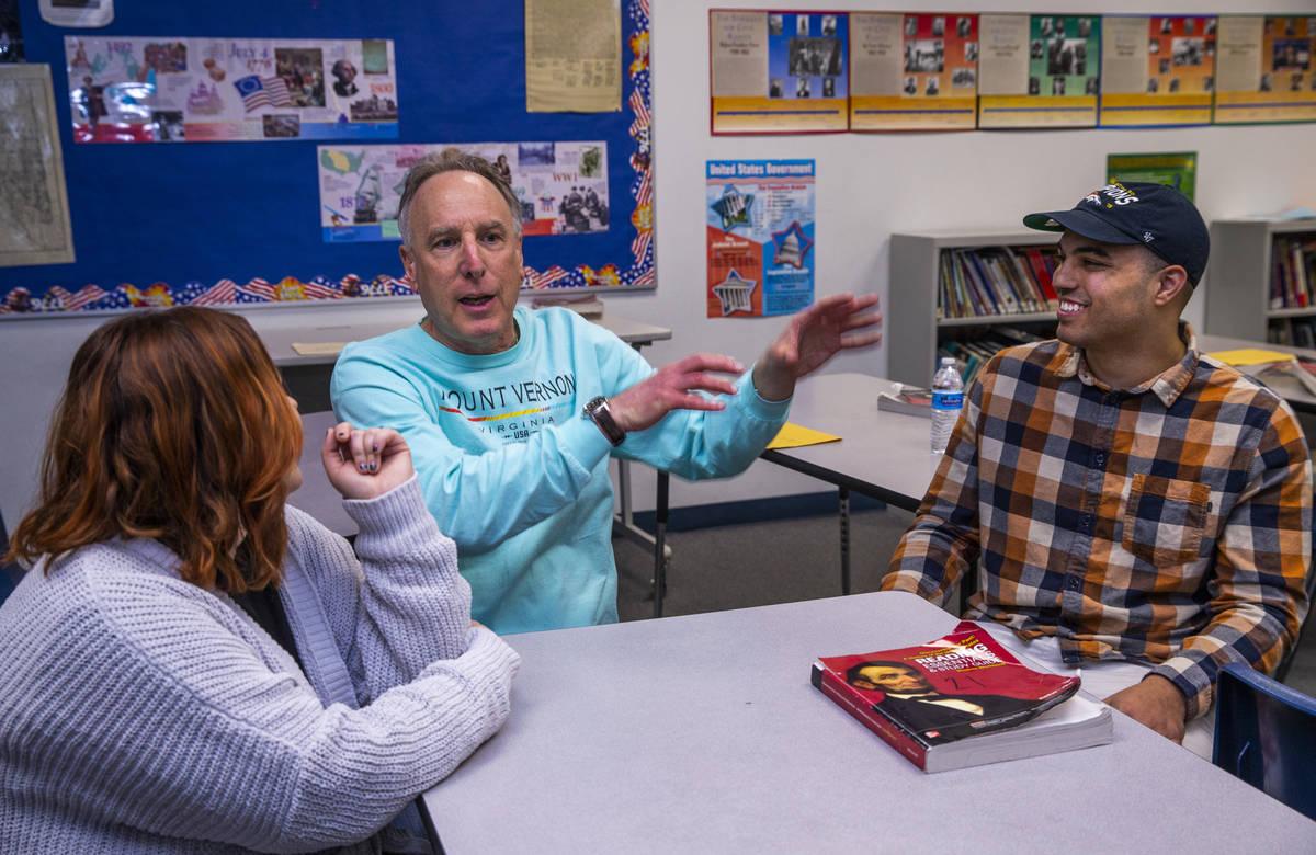 Leavitt Middle School history teacher Mitchell Kalin, center, talks about their class experienc ...