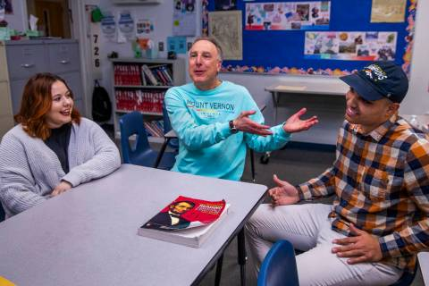 Leavitt Middle School history teacher Mitchell Kalin, center, talks about their class experienc ...