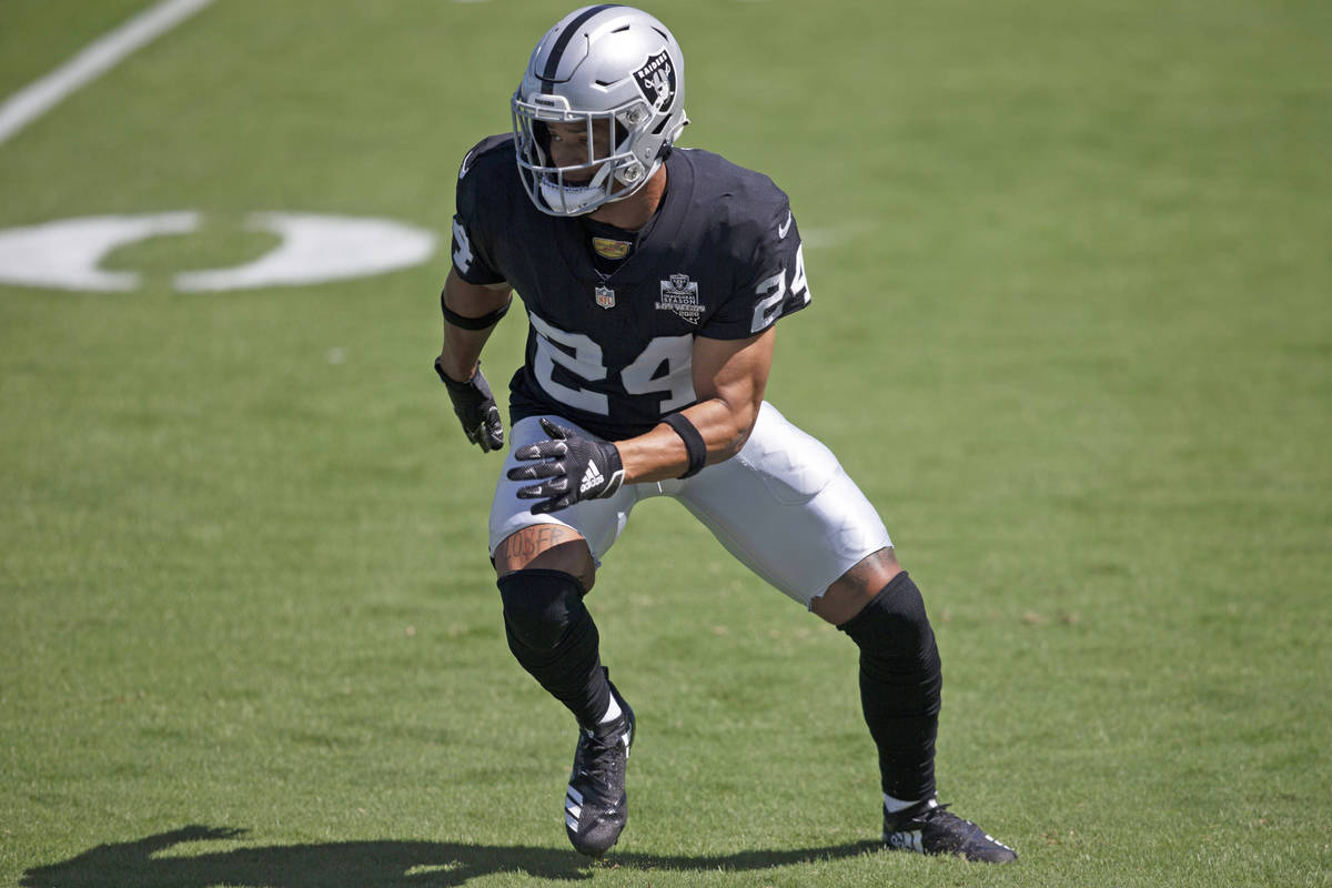 Las Vegas Raiders safety Johnathan Abram (24) warms up before an NFL football game against the ...