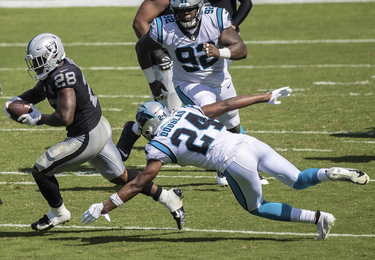 Las Vegas Raiders running back Josh Jacobs (28) runs up field past Carolina Panthers cornerback ...