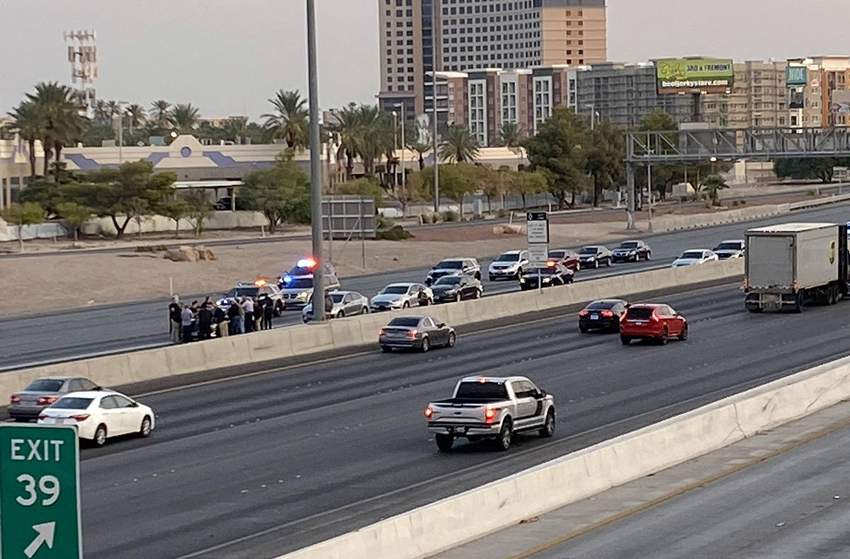 Las Vegas police investigate a fatal two-vehicle crash on Interstate 15 near Flamingo Road, whi ...