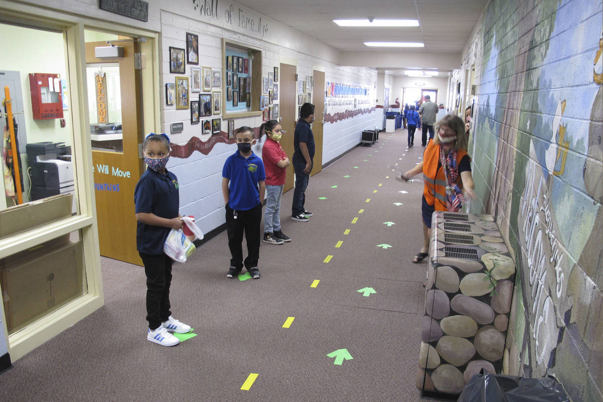 FILE - In this Aug. 18, 2020, file photo, students return to Greenbrae Elementary School in Spa ...