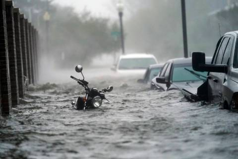 Flood waters move on the street, Wednesday, Sept. 16, 2020, in Pensacola, Fla. Hurricane Sally ...