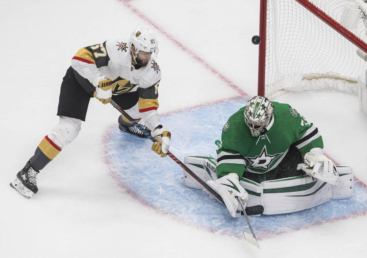 Dallas Stars goalie Anton Khudobin (35) makes a save on Vegas Golden Knights' Max Pacioretty (6 ...