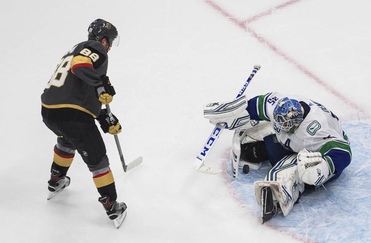 Vancouver Canucks goalie Thatcher Demko (35) makes a save on Vegas Golden Knights' Nate Schmidt ...