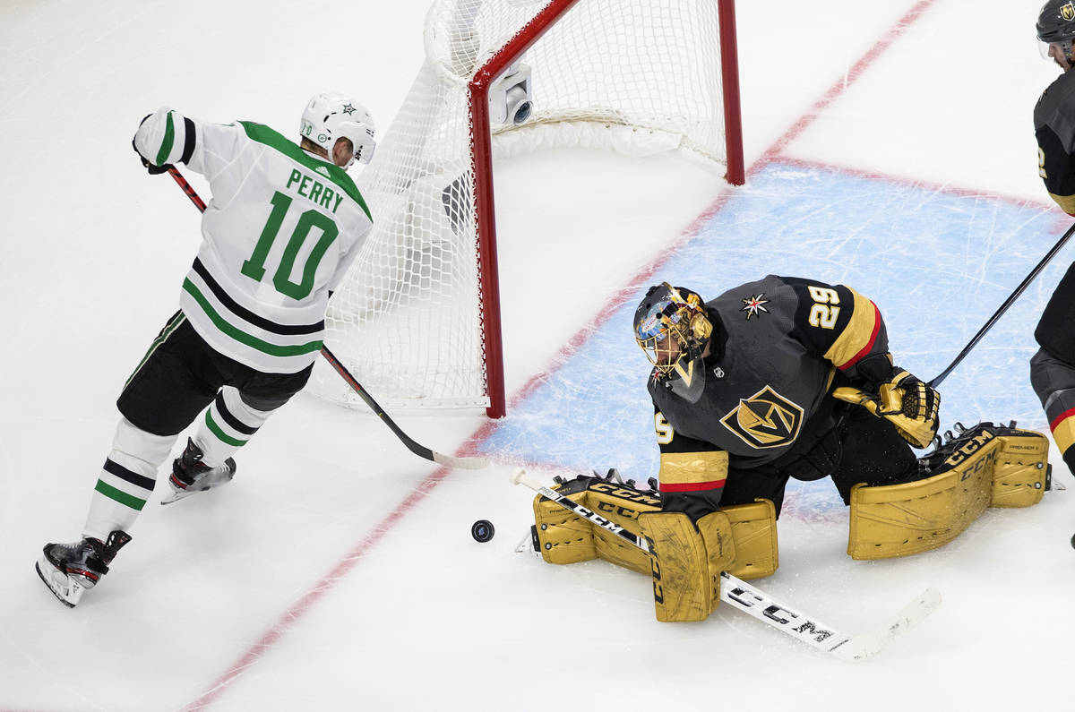 Vegas Golden Knights goalie Marc-Andre Fleury (29) stops Dallas Stars' Corey Perry (10) during ...