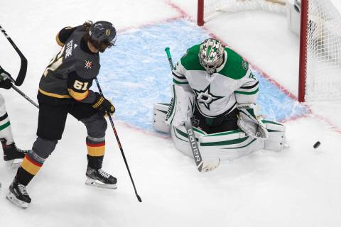 Vegas Golden Knights' Mark Stone (61) is stopped by Dallas Stars goalie Anton Khudobin (35) dur ...