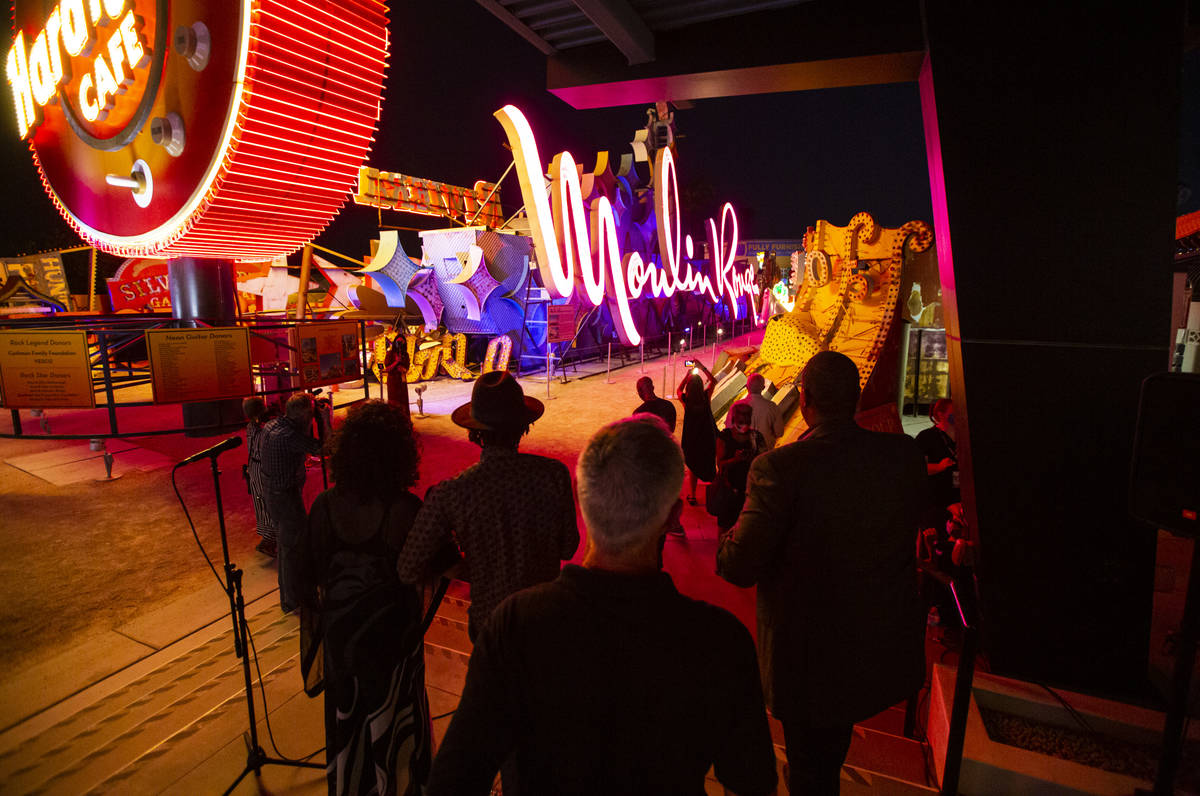 Rob McCoy, president and CEO of the Neon Museum,ʣenter, watches alongside Dee Dee Jasmine ...