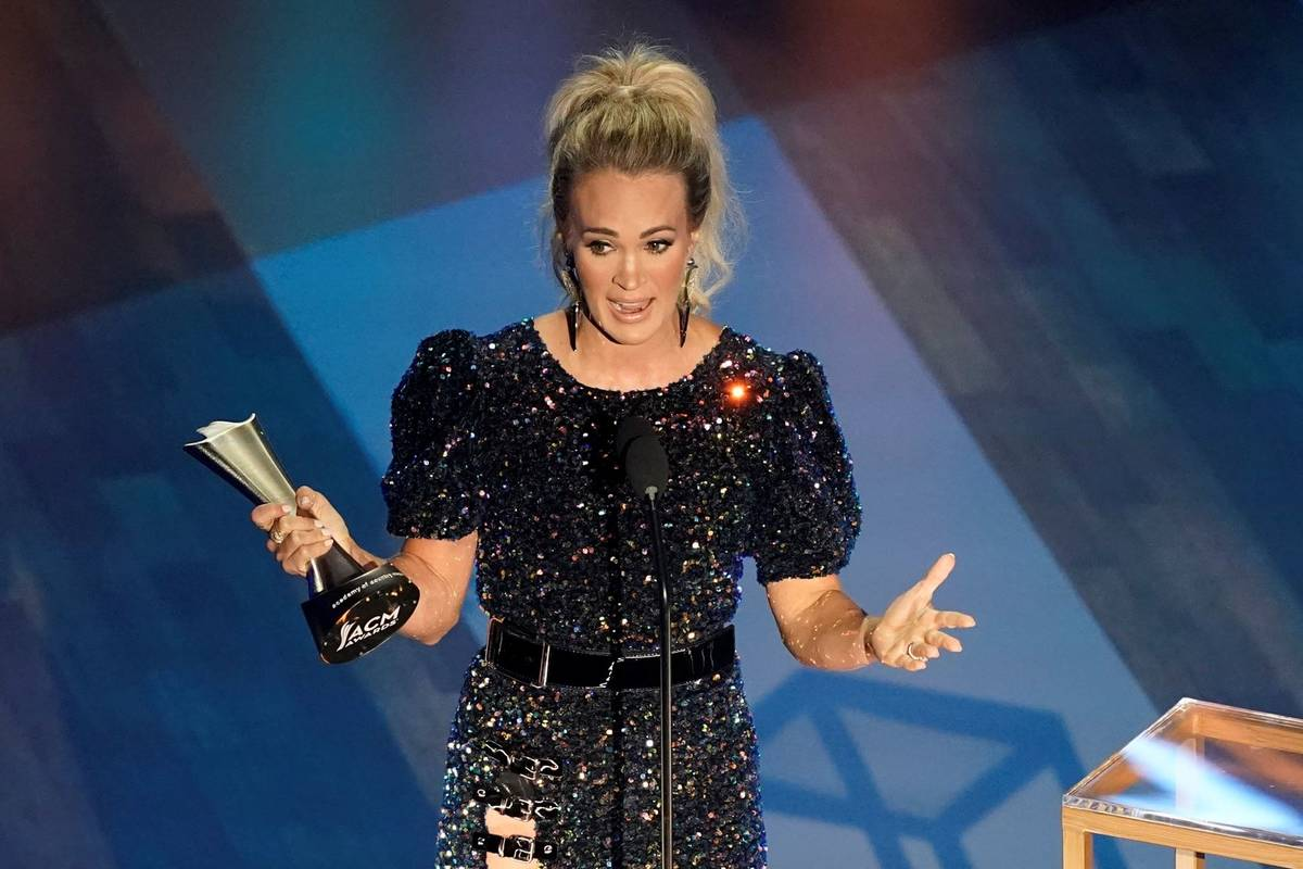Carrie Underwood accepts the entertainer of the year award during the 55th annual Academy of Co ...