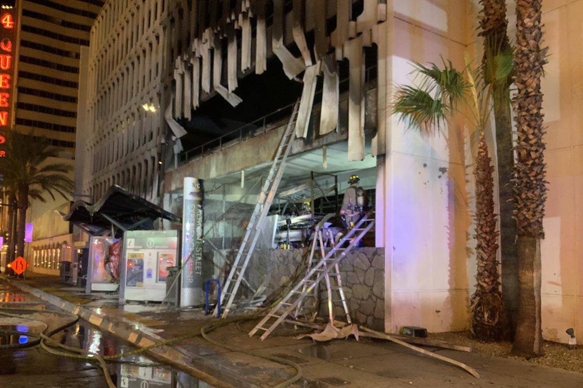 At least five vehicles caught fire on the first level of the 4 Queens Hotel & Casino parking ga ...