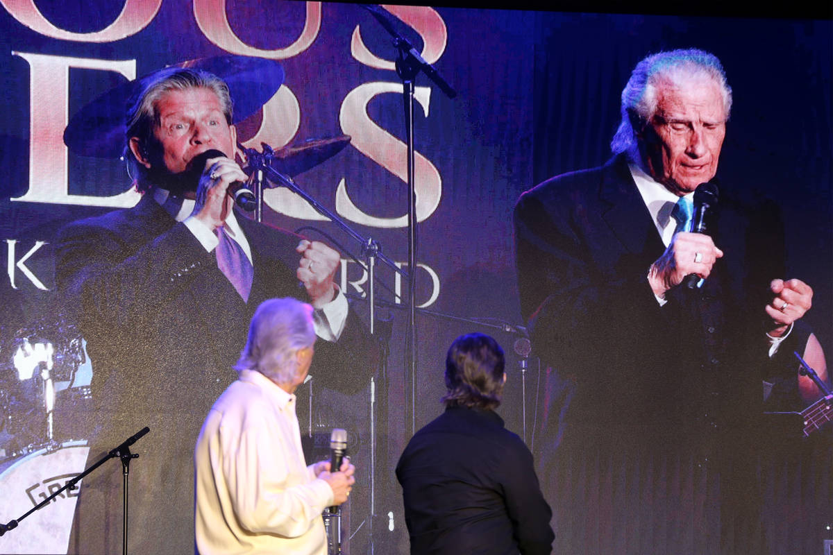 Bill Medley, left, and Bucky Heard of the Righteous Brothers watch a video of a past performanc ...