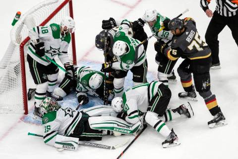 Dallas Stars' goalie Anton Khudobin (35) makes a save and covers the puck against the Vegas Gol ...