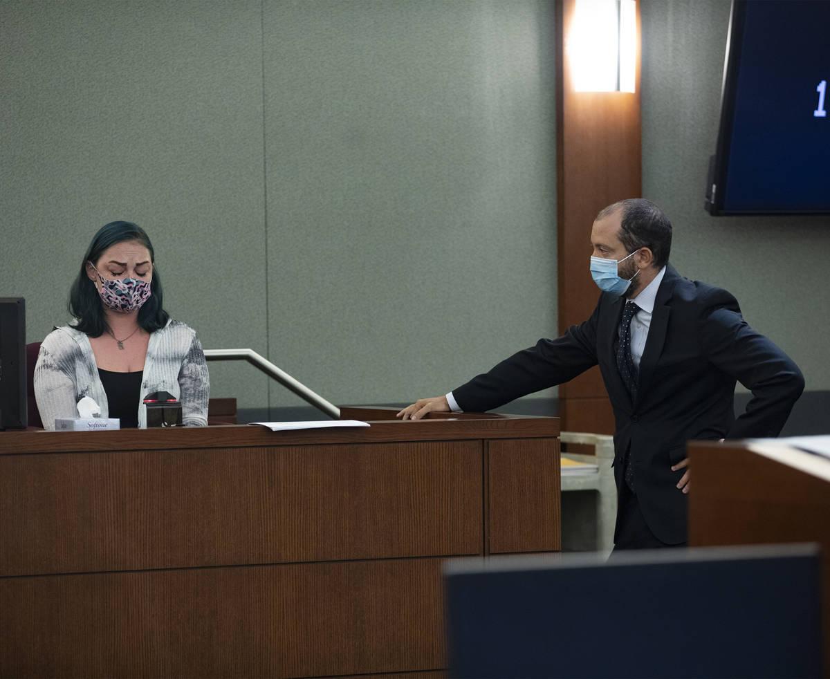 Prosecutor Christopher Hamner, right, cross-examines Alisha Burns, left, during an evidentiary ...