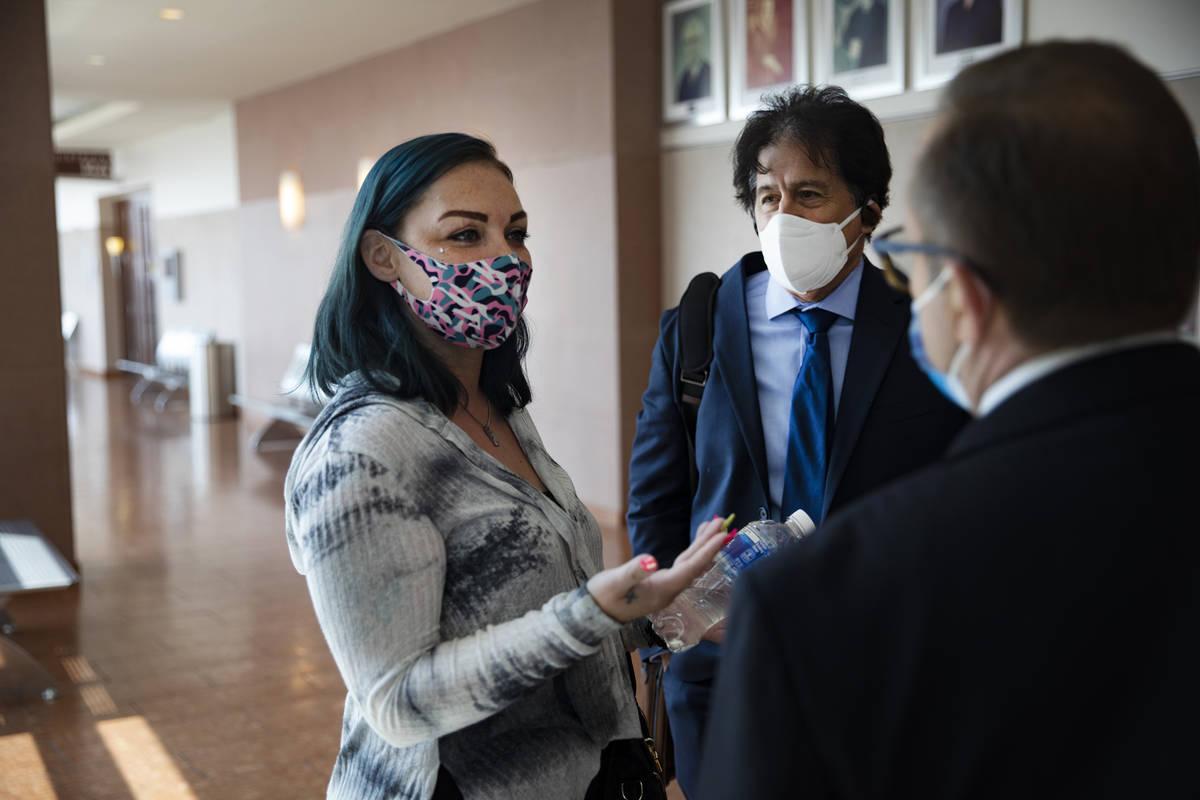 Alisha Burns speaks with her lawyer Tony Abbatangelo, right, and law clerk Robert Rose, center, ...