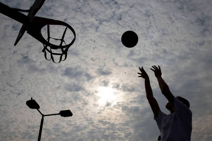 Matthew Chavez is silhouetted as he plays basketball at Charlie Frias Park, on Friday, Sept. 18 ...