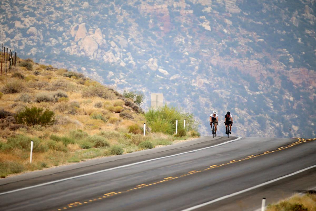 Cyclists ride on Red Rock Canyon Road in Las Vegas, Friday, Sept. 18, 2020. (Erik Verduzco / La ...
