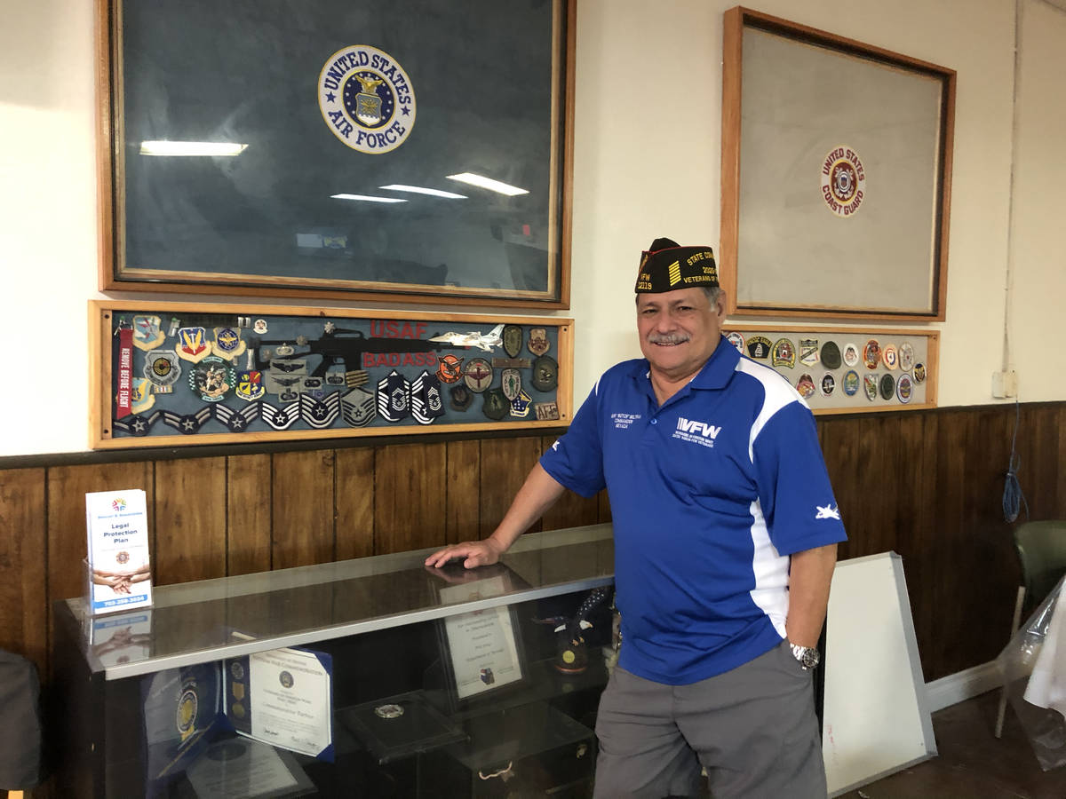 "Henry ""Butch"" Beltran, 70, Nevada State VFW Commander posing in front of an Air Force display c ..."