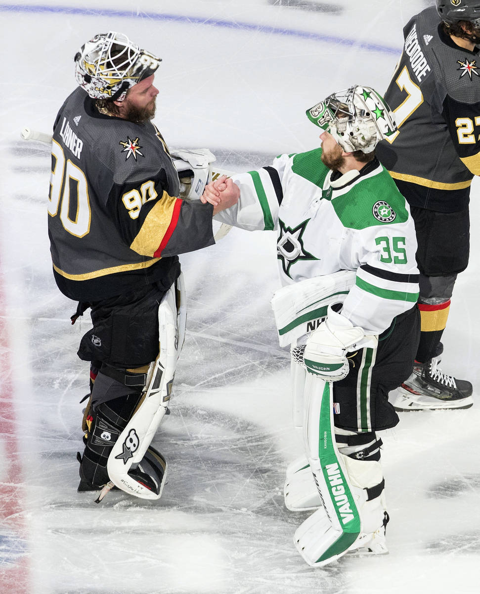 Dallas Stars goalie Anton Khudobin (35) and Vegas Golden Knights goalie Robin Lehner (90) shake ...