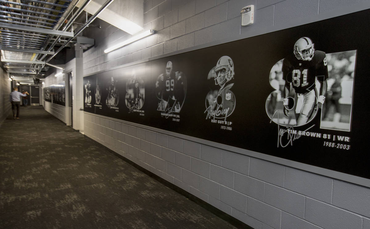 Las Vegas Raiders players will pass a team hall of fame wall on the way to and from their locke ...