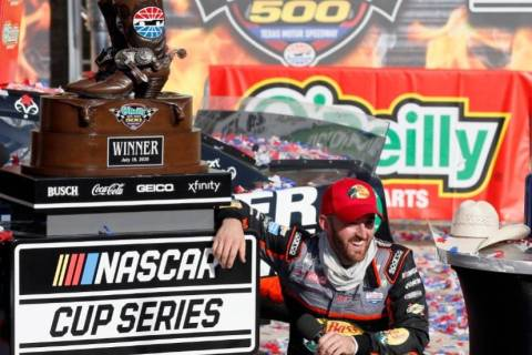 Austin Dillon smiles as he takes a knee in Victory Lane to catch his breath after winning a NAS ...
