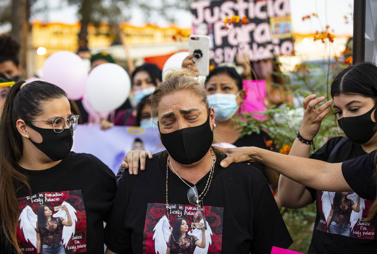 Aracely Palacio, center, is comforted while talking about her daughter Lesly Palacio, who was f ...