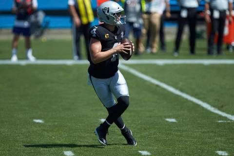 Las Vegas Raiders quarterback Derek Carr (4) drops back to pass during an NFL football game aga ...
