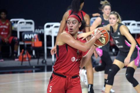 Las Vegas Aces forward Dearica Hamby (5) controls the ball during the first half of a WNBA bask ...