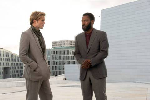 "Robert Pattinson, left, and John David Washington star in a scene from ""Tenet."" (Melinda Sue Go ..."