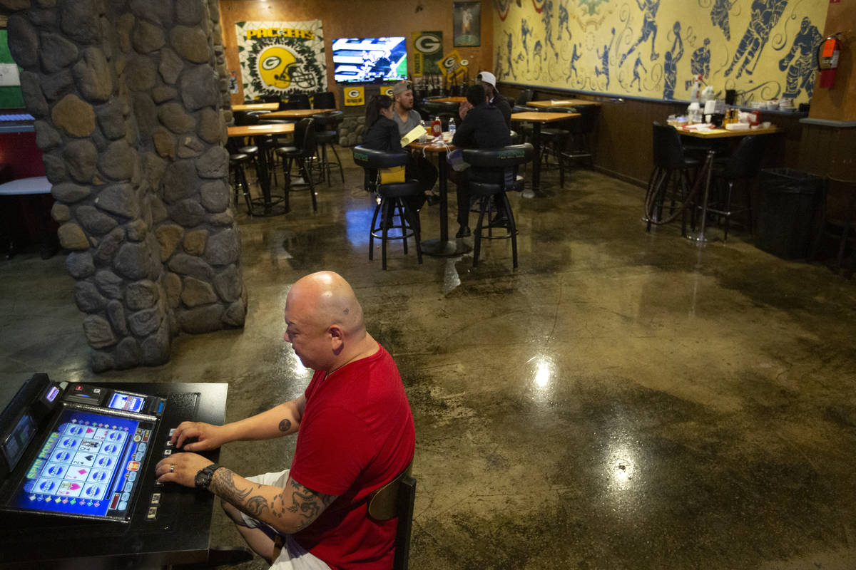 Benji Chen plays video games at Jackson's Bar and Grill in the early hours of the morning on Mo ...