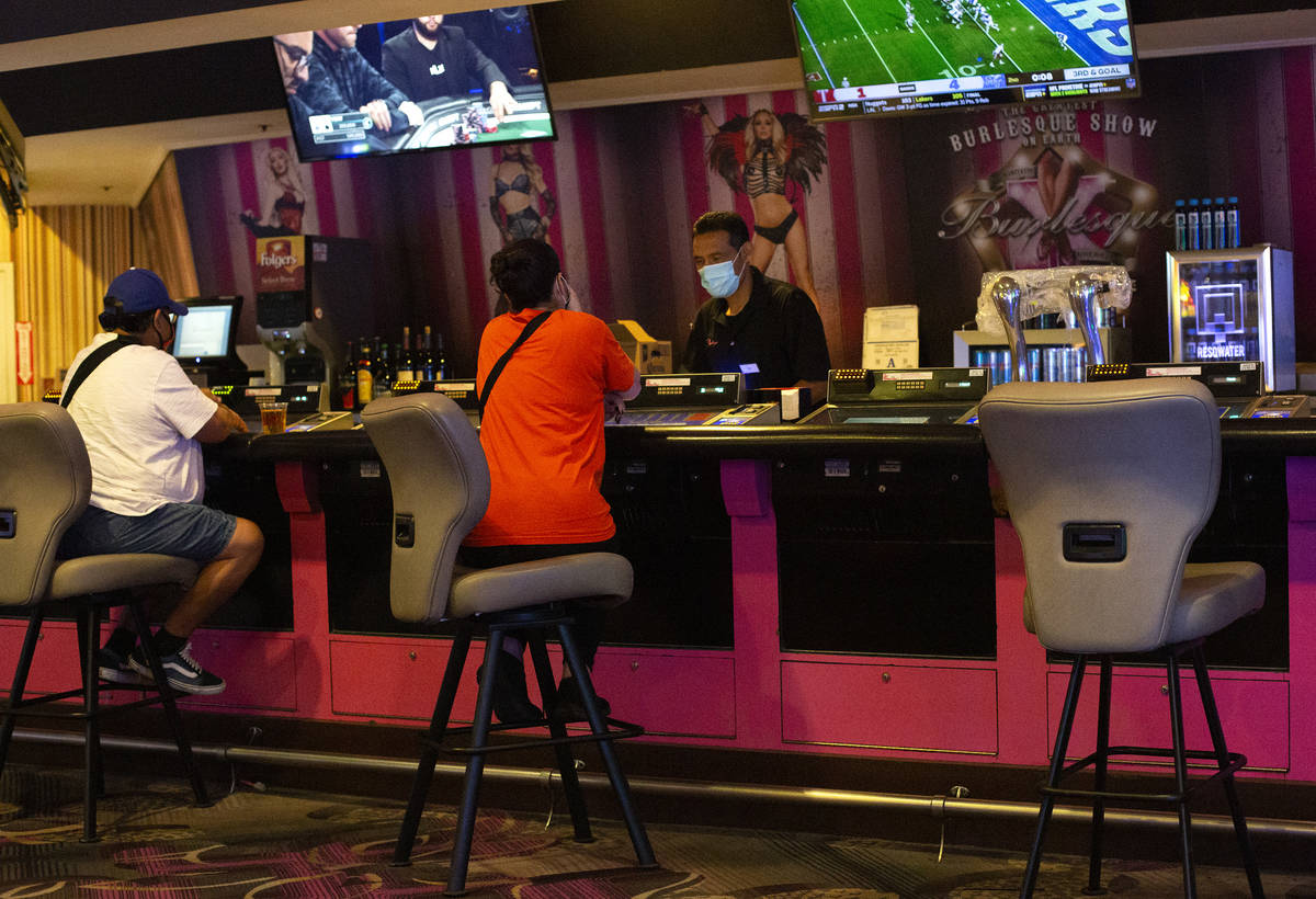 Chairs at a bar in Flamingo Las Vegas are spaced out to maintain social distance on Monday, Sep ...