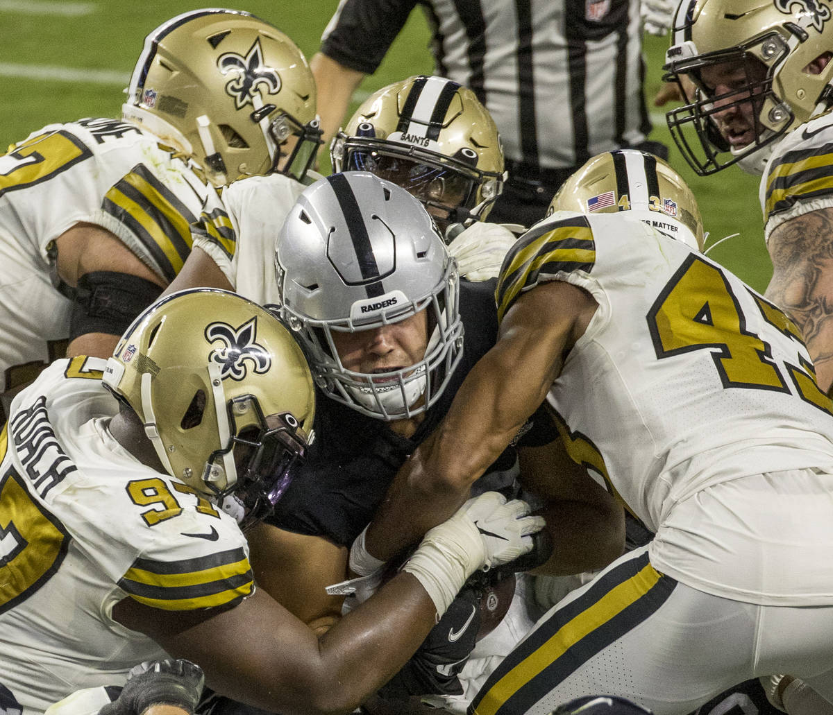 Las Vegas Raiders fullback Alec Ingold (45) attempts to drive across the goal line past New Orl ...