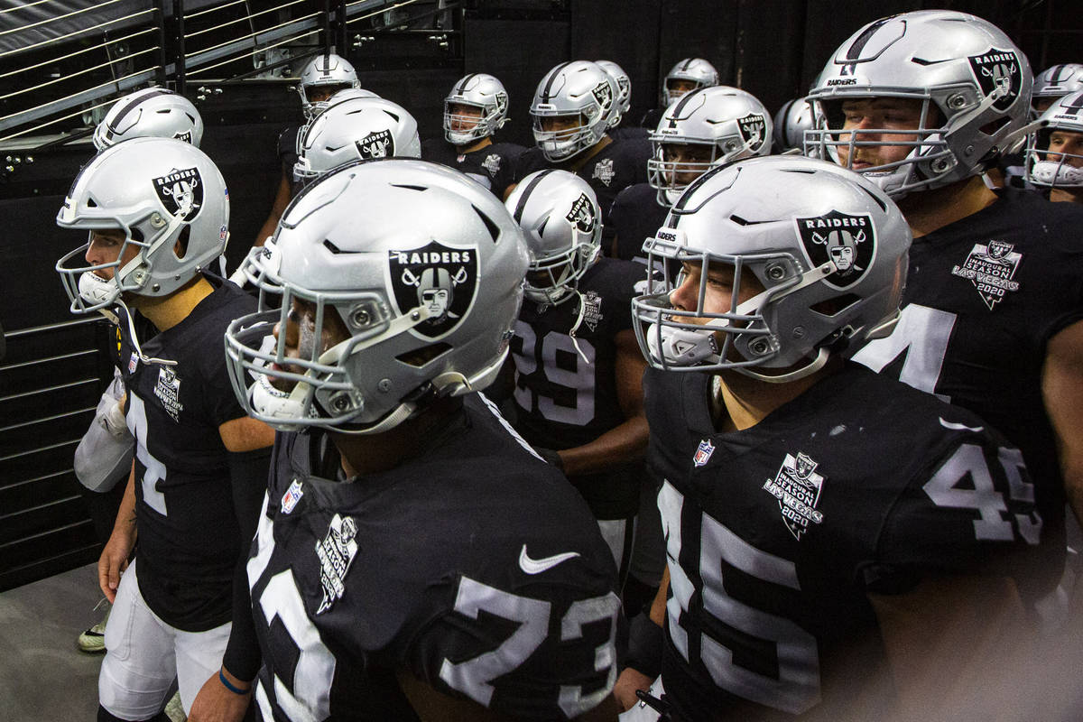 Las Vegas Raiders players get ready to take the field for the start of their home opening NFL g ...
