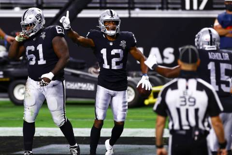 Las Vegas Raiders wide receiver Zay Jones (12) celebrates after scoring a touchdown against the ...