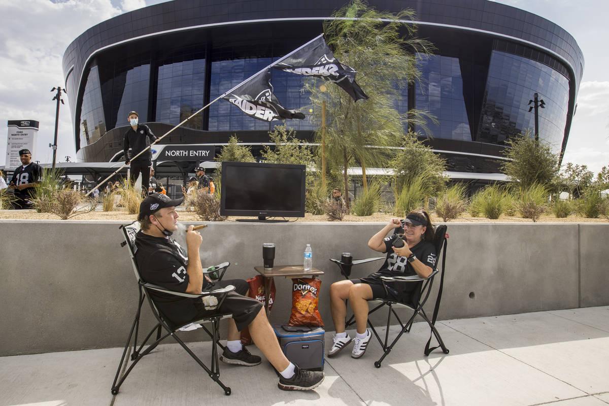 Las Vegas Raiders fans Kenna James, left, and Julie Goldman have their spot set up outside seve ...