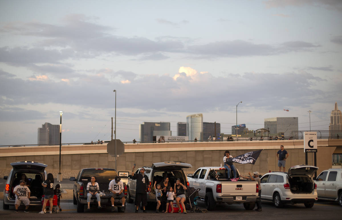 Raiders fans gather outside Allegiant Stadium for the Raiders' first home game on Monday, Sept. ...