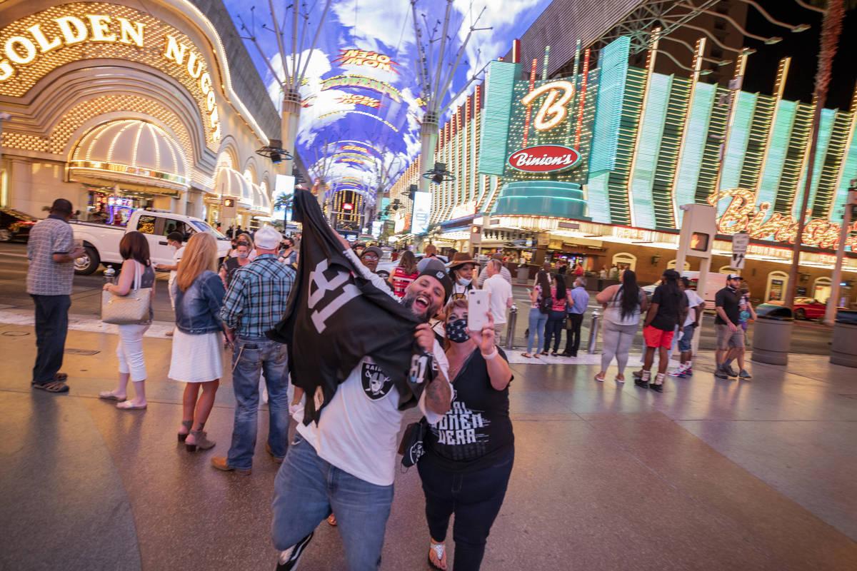 Raiders fans from Rio Rancho, New Mexico, Christopher Rodarte, left, and his mom Brenda Ortiz, ...