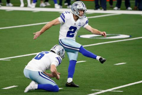Dallas Cowboys' Chris Jones (6) holds as kicker Greg Zuerlein (2) kicks a field goal in the clo ...