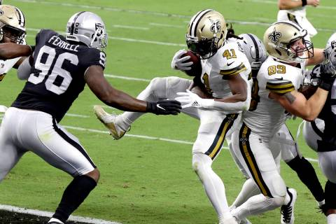 New Orleans Saints running back Alvin Kamara (41) scores a touchdown against the Las Vegas Raid ...