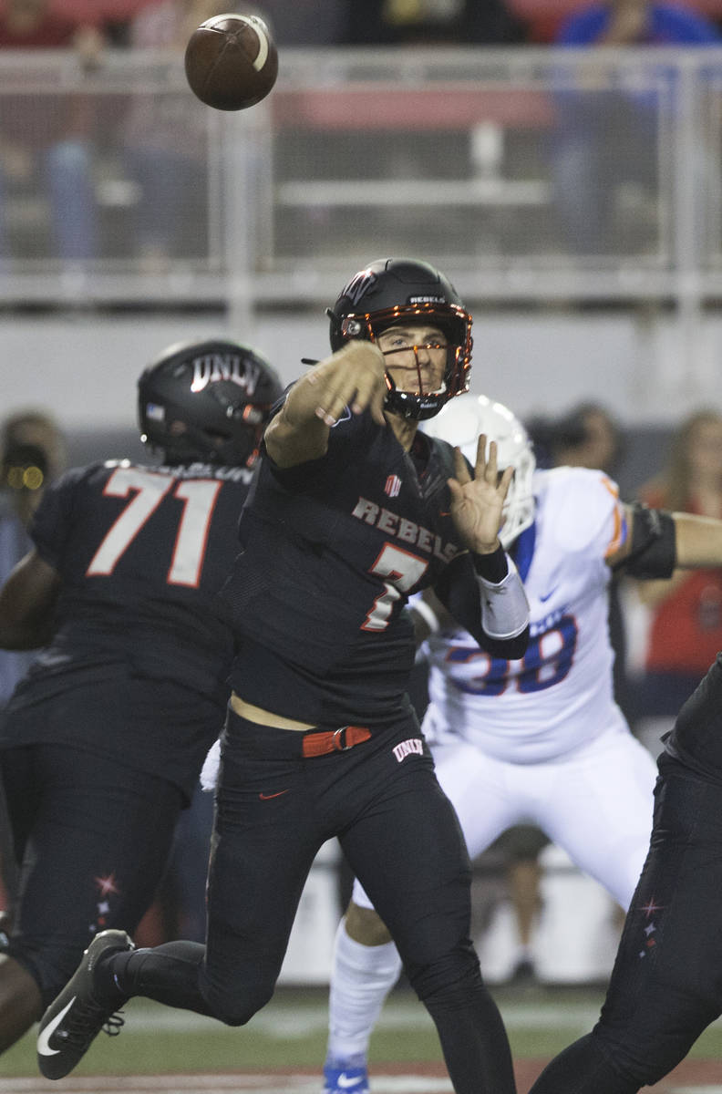UNLV Rebels quarterback Kenyon Oblad (7) makes a sideline pass before the rush from Boise State ...