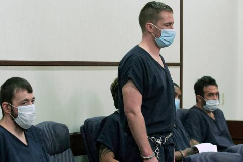 Benjamin Ames, center, appears in a Henderson courtroom on Tuesday, Sept. 15, 2020. Ames is acc ...
