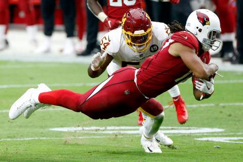Arizona Cardinals wide receiver Larry Fitzgerald makes a catch as Washington Football Team line ...