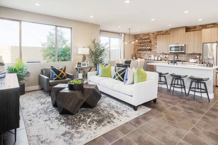 The Plan Two model in Pardee's gated Evolve town home community is fully furnished, landscape ...