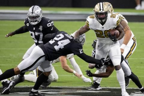 New Orleans Saints running back Latavius Murray (28) breaks the tackle of Las Vegas Raiders saf ...