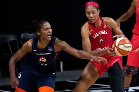 Connecticut Sun forward Alyssa Thomas (25) knocks the ball away from Las Vegas Aces center A'ja ...