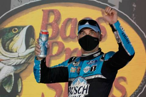 Kevin Harvick celebrates in Victory Lane after his win in the NASCAR Cup Series auto race Satur ...