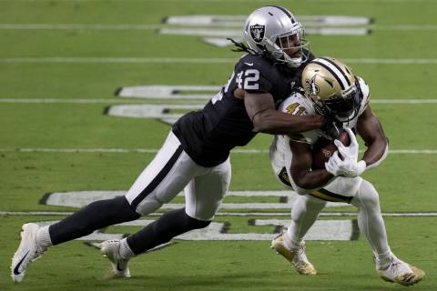 Las Vegas Raiders inside linebacker Cory Littleton (42) tackles New Orleans Saints running back ...