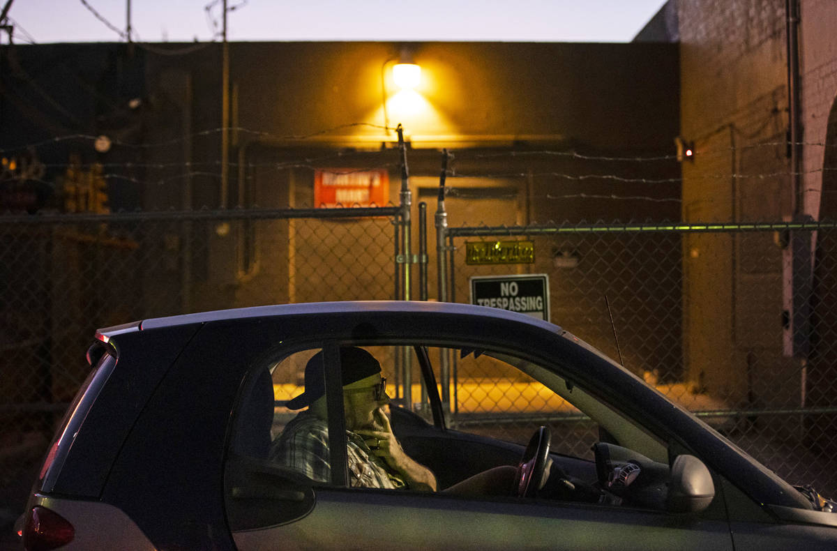 """Director Troy Heard watches from his car during a rehearsal of """"The Parking Lot"""" outs ..."""