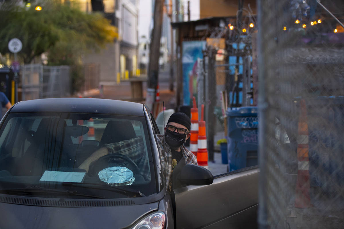 """Director Troy Heard looks out from his car before the start of a rehearsal of """"The Parking ..."""